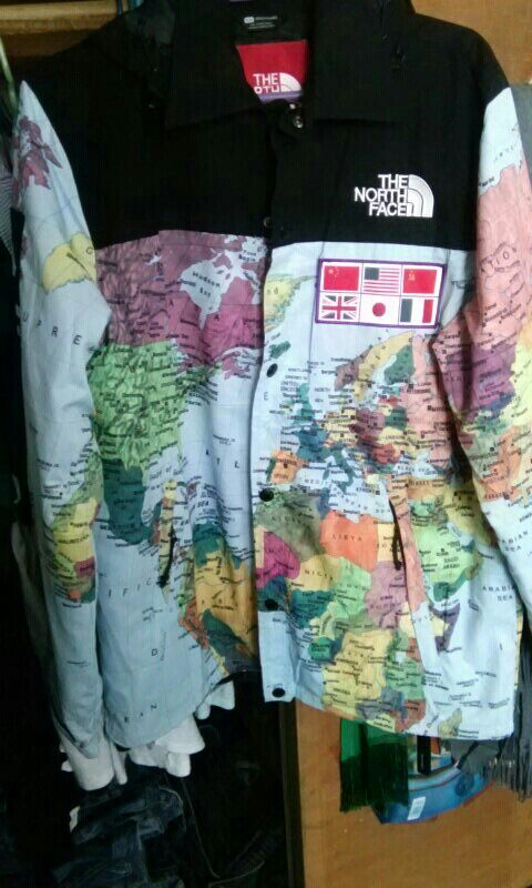 on supreme map jacket